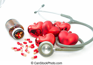 Stethoscope listening to a healthy red hearts  and  bottle with colorful pills