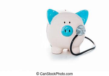 Stethoscope listening to piggy bank