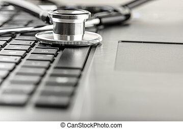 Stethoscope lying on a laptop keyboard