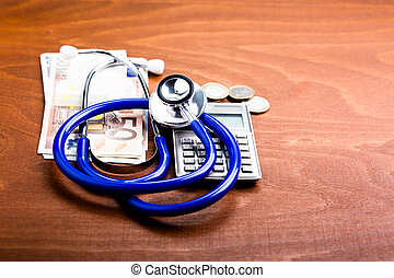 Stethoscope on a calculator and money