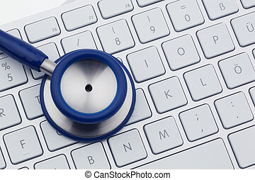 Stethoscope on computer keyboard - A stethoscope is on the...