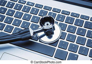Stethoscope on laptop keyboard in pale blue hospital colors