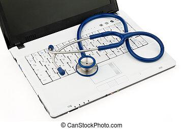 stethoscope on laptop.