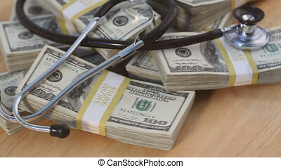 Stethoscope on Piles of Cash
