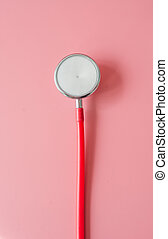 Stethoscope on pink background.