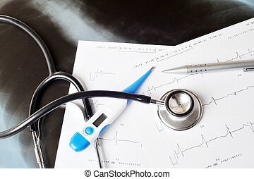 stethoscope on  printout of  heart monitor -blue tint