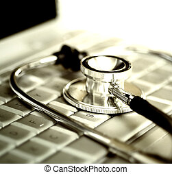 stethoscope over laptop keyboard