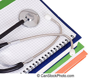 stethoscope, pad and books - stethoscope on pad and books