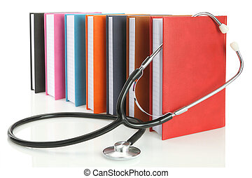 Stethoscope with a stack of books isolated on white