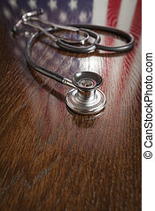 Stethoscope with American Flag Reflection on Table
