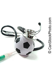 Stethoscope with football and syringe on a white background