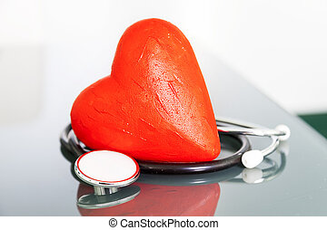 stethoscope with red heart close up