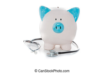 Stethoscope wrapped around blue and white piggy bank