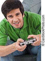 steuerung, junger, spiel- auflage, video, mann, spielende , glücklich