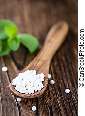 Stevia sweetener on wooden background - Wooden table with...