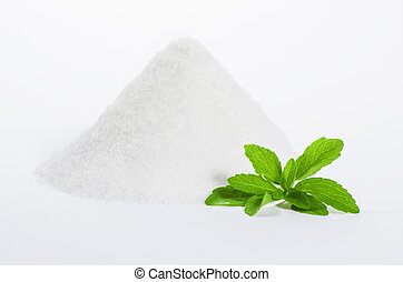 stevia with a pile of sugar - stevia leaves with a pile of...