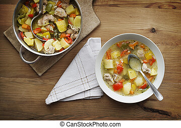 Stew - Serve warm stew with vegetables and meat on the plate