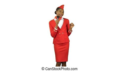 African American stewardess in a red suit sings songs and dances to the beat of the music . Alpha channel