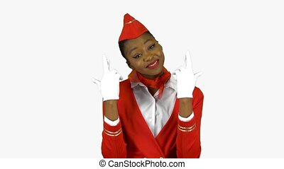 Stewardess afro american crossed her fingers on both hands in the hope of success. Alpha channel