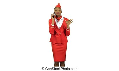 Stewardess afro american speaks on the phone and steps away...