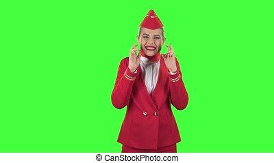 Stewardess crossed her fingers. Green screen