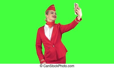Stewardess does selfi, she likes to take pictures of herself. Green Screen