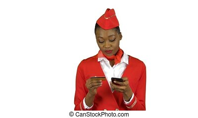 Stewardess girl afro american is picking up the credit card...