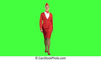 Stewardess goes and welcomes those around her, wearing a red scarf around her neck. Green screen