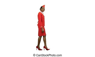 Stewardess goes and welcomes those around her, wearing a red scarf around her neck. Alpha channel. Side view