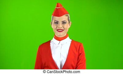 Stewardess in a red suit takes off her sunglasses. Green Screen