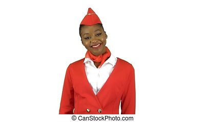 Stewardess afro american in gloves shows a finger up. Alpha channel