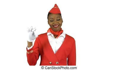 Stewardess afro american in gloves shows okey. Alpha channel