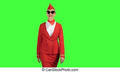 Stewardess in sunglasses goes and winks. Green Screen -...