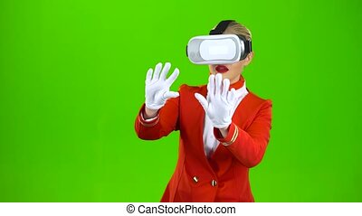 Stewardess in the glasses of virtual reality . Green screen...