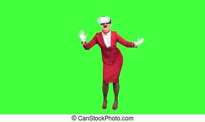 Stewardess in the glasses of virtual reality plays a game experiencing different emotions of happiness. Green screen