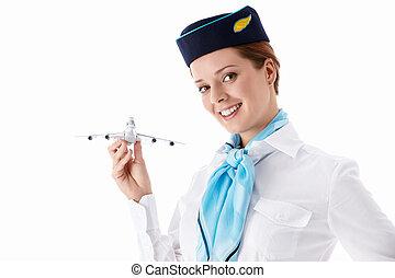 Stewardess in uniform on a white background
