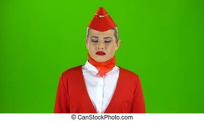 Stewardess is disappointed. Green screen