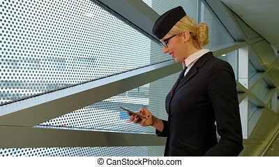 Stewardess is reading a message on your smartphone and smiles.