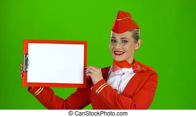Stewardess raises a red folder with a white sheet of paper. Green screen
