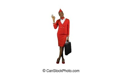 Stewardess afro american shows okey with a case in hand. Alpha channel