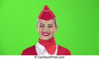 Stewardess smiles looks into the distance. Green screen....