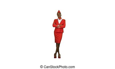 African American stewardess in a red suit and scarf is standing and flirting. Alpha channel