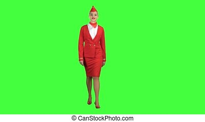 Stewardess steps forward and looks in front of her. Green screen