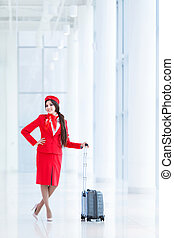 Stewardess with luggage