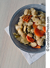 stewed beans with carrots and onion in a bowl