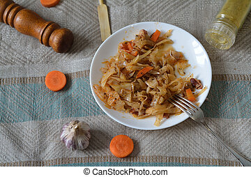stewed cabbage on a plate with a fork and spices