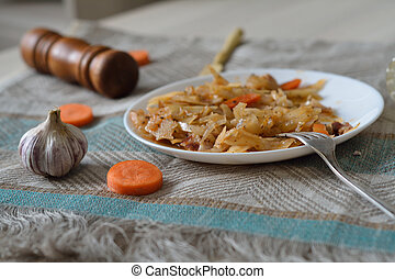 Stewed cabbage with a fork