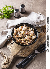 Stewed chicken fillet with mushrooms