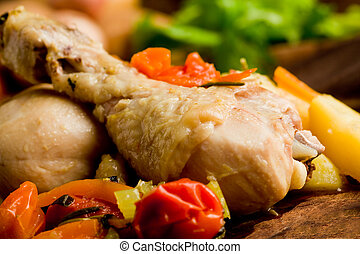 delicious stewed chicken with vegetables inside rustical wooden plate