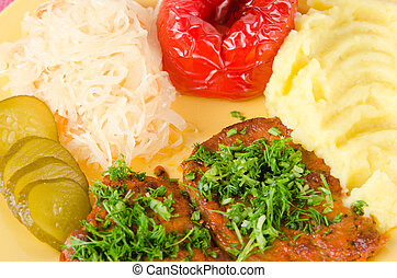 Stewed meat with vegetables on a garnish